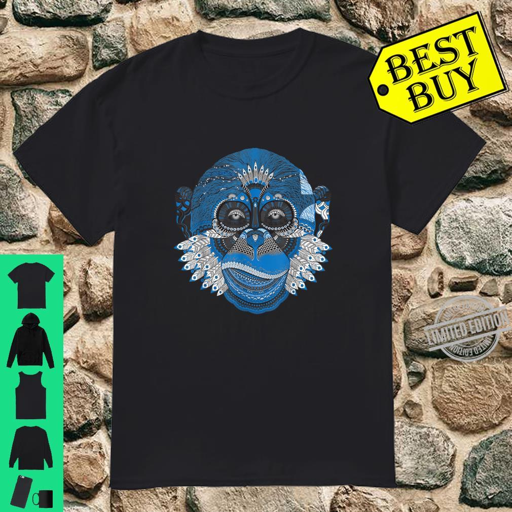 Beautiful monkey head with feathers disguised as an Indian. Shirt